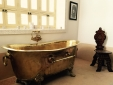 Gold bath tube in the Berber Suite