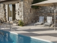 Small but clean and crystal clear: pool made of travertine and glas tiles