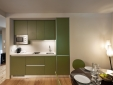 Green Apartment: kitchenette and dining area