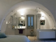 bedroom and bathroom open-plan en suite shower and W.C living room with dining area  Palazzina Alchimia Fasano Puglia