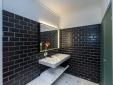 Black marmored bathroom at  Divina Suites Hotel Boutique