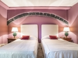 this bedroom with 2 single beds is carved into the rock